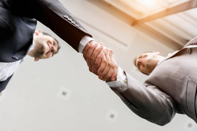 Businessmen shaking hands. Getty Images