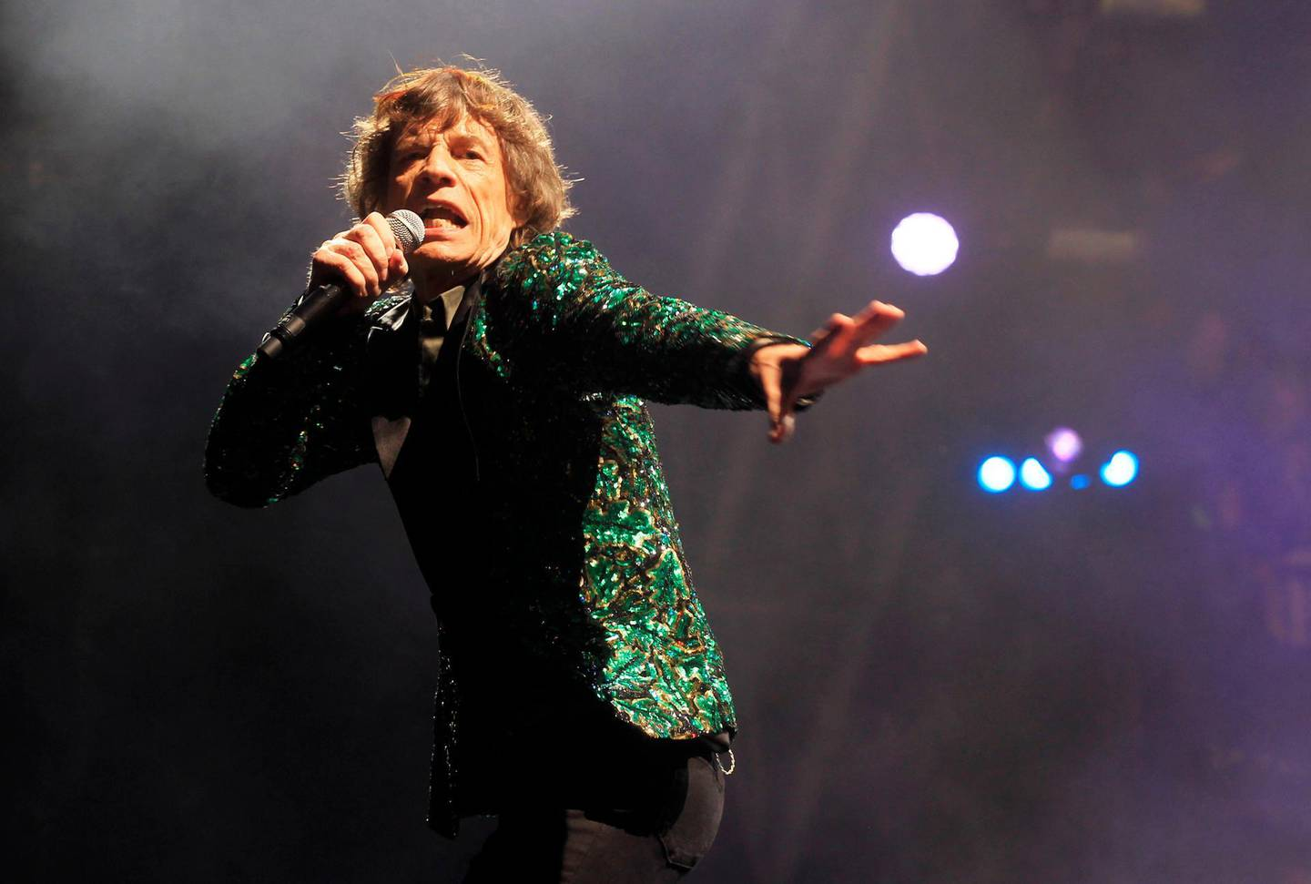 FILE - Mick Jagger of The Rolling Stones performs in Glastonbury, England on June 29, 2013. Jagger's jacket is among 55 L'Wren Scott creations going on sale this week at Christie's in London. (Photo by Jim Ross/Invision/AP, File)