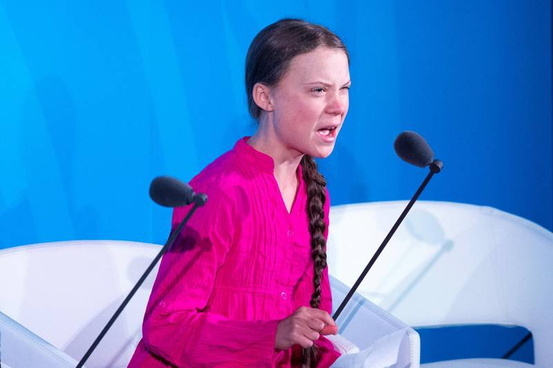 """(FILES) In this file photograph taken on September 23, 2019, youth climate activist Greta Thunberg speaks during the UN Climate Action Summit on September 23, 2019 at the United Nations Headquarters in New York City. - Sitting on cold stone in front of the Stockholm Parliament: an anonymous teenager until a year ago, Greta Thunberg became the environmental conscience of the world and the voice of a generation exasperated by the inaction of its leaders. It all began in August 2018 when the 16-year-old Swede began the """"school climate strike"""". Armed with a cardboard sign, she quickly attracted the attention of the Swedish and then international media, and in a few months the girl with Asperger's syndrome became the pasionaria of the blue planet. (Photo by Johannes EISELE / AFP)"""