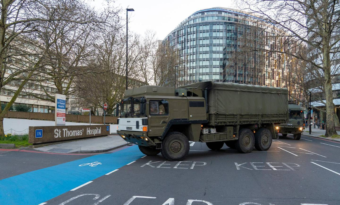 In this photo issued Tuesday March 24, 2020, Britain's Ministry of Defence, showing soldiers from Royal Logistics Corps delivering facemasks to St Thomas' Hospital in London, as part of the military force's efforts to support the government amidst the Coronavirus crisis, Tuesday March 24, 2020.  The forces collected some lorry loads of medical facemasks and drove overnight some two-hundred miles (over 300 Km) to deliver them to St. Thomas's Hospital.  The highly contagious COVID-19 coronavirus can cause moderate symptoms, but for some it can cause severe illness including pneumonia. (Dave Jenkins/MoD via AP)