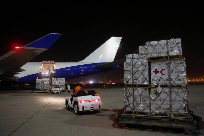 Workers load aid onto an airplane to be delivered to Rohingya refugees residing in Bangladesh, in coordination between UNHCR and United Arab Emirates, at Dubai airport, UAE, October 11, 2017. REUTERS/Satish Kumar