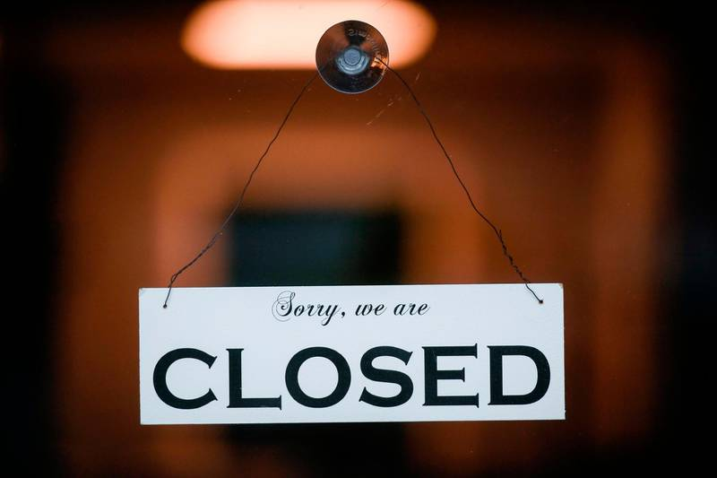 A sign reading 'Sorry, we are closed' is seen at a shop in Cologne, western Germany on January 4, 2021 amid the ongoing novel coronavirus / COVID-19 pandemic. German Chancellor Angela Merkel and state leaders are expected Tuesday, January 5, 2021 to extend a partial lockdown in Europe's top economy as coronavirus deaths continue to mount despite tough restrictions in the run-up to the holidays. / AFP / Ina FASSBENDER