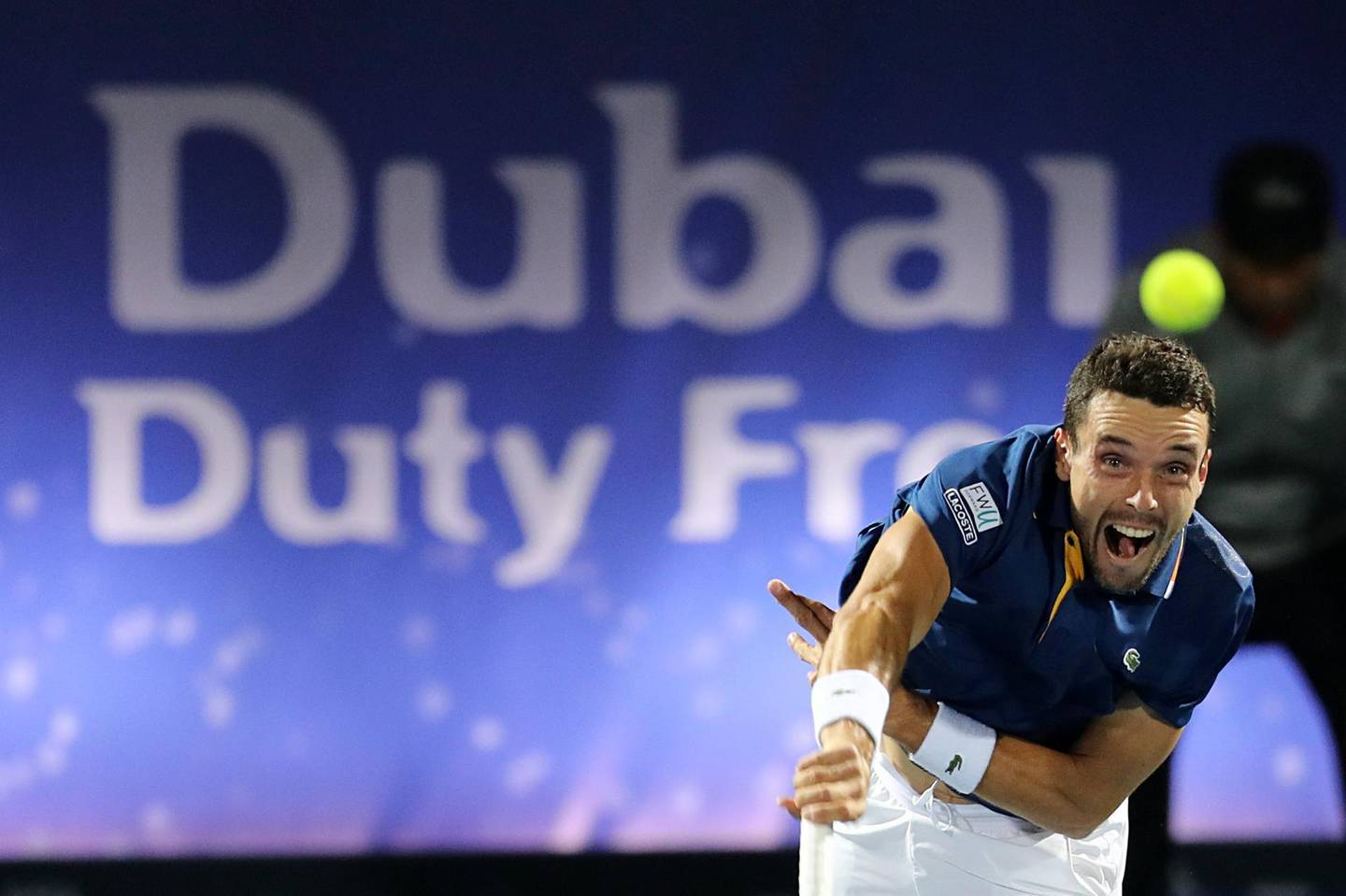 epa06577367 Roberto Bautista Agut of Spain in actoin against Lucas Pouille of France in the Men's Singles Final match of the ATP Dubai Duty Free Tennis Championships in Dubai, United Arab Emirates, 03 March 2018.  EPA/MAHMOUD KHALED