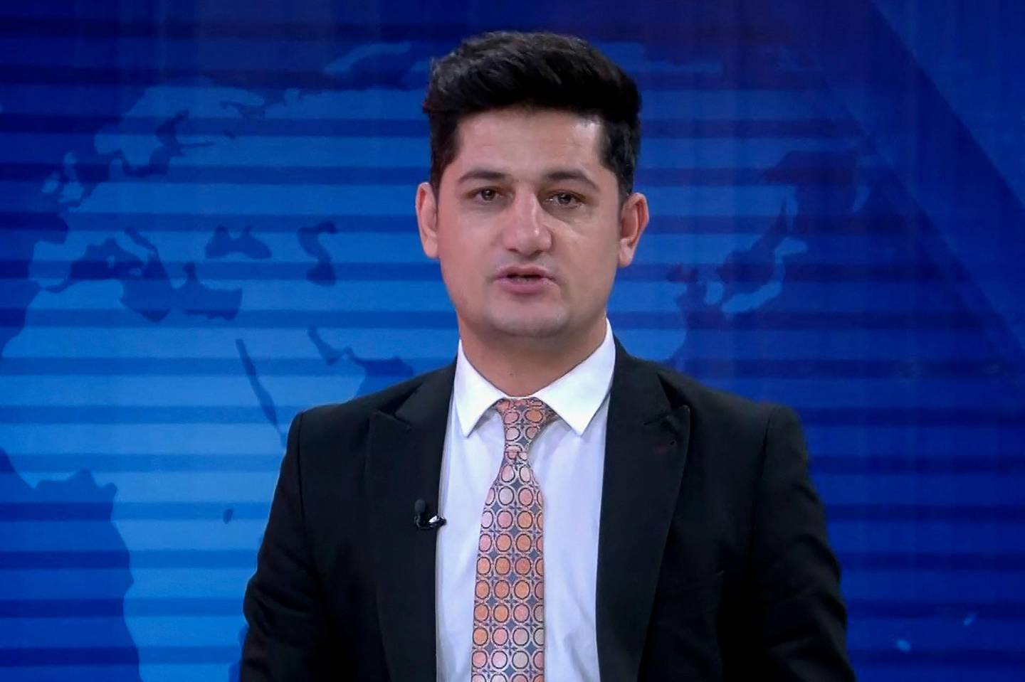 """In this unadated handout screengrab released by TOLOnews television journalist Nemat Rawan is seen during a news broadcast of ToloNews channel. A high-profile Afghan television journalist was shot dead in southern Kandahar city on May 6, officials said, a day after the Taliban warned against """"biased reporting"""" by the media. - RESTRICTED TO EDITORIAL USE - MANDATORY CREDIT """"AFP PHOTO /TOLOnews"""" - NO MARKETING - NO ADVERTISING CAMPAIGNS - DISTRIBUTED AS A SERVICE TO CLIENTS    / AFP / TOLONEWS / - / RESTRICTED TO EDITORIAL USE - MANDATORY CREDIT """"AFP PHOTO /TOLOnews"""" - NO MARKETING - NO ADVERTISING CAMPAIGNS - DISTRIBUTED AS A SERVICE TO CLIENTS"""