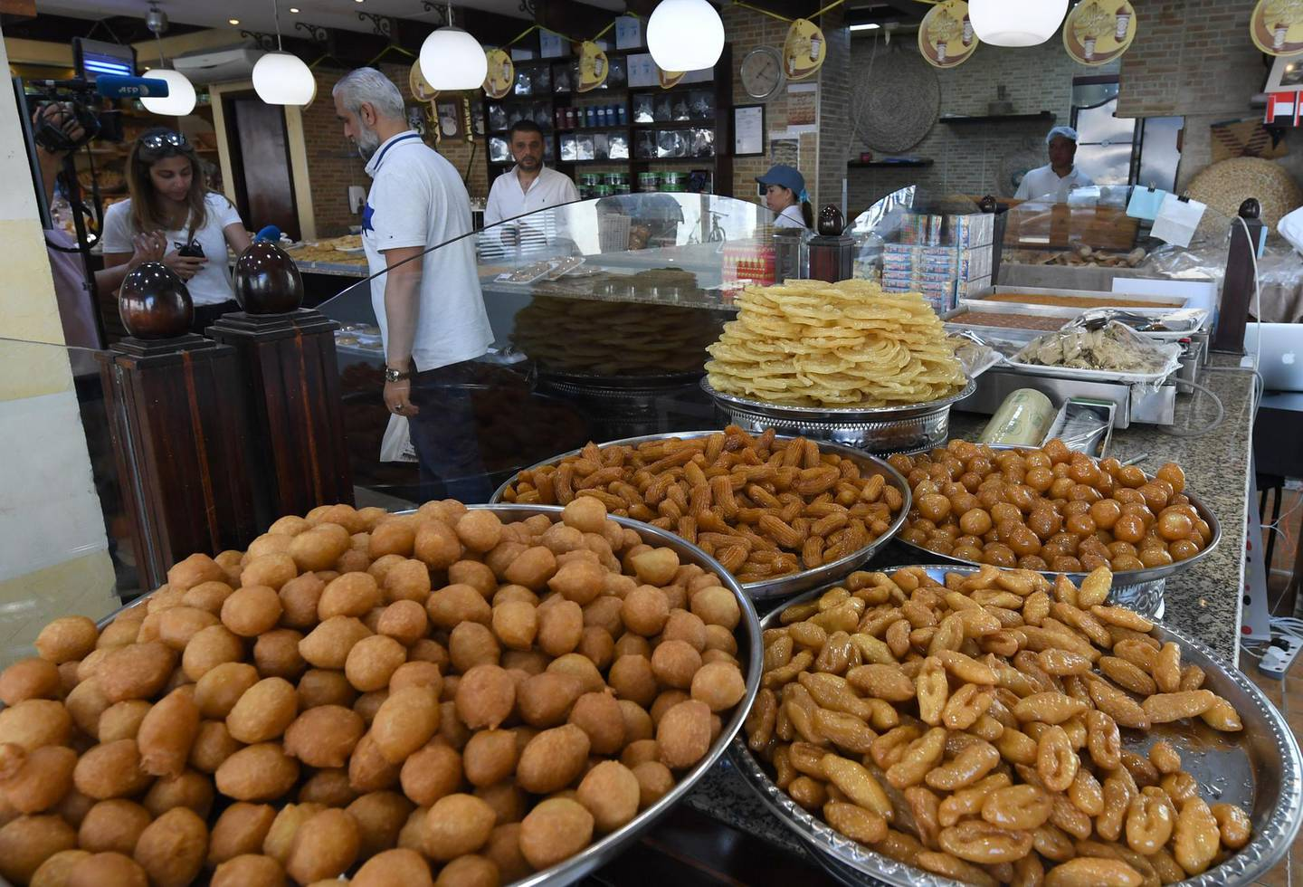 The al-Rabat Sweets and Bakery, founded by Iraqi immigrants in the UAE, is pictured during the Muslim holy month of Ramadan, in Sharjah on May 28, 2019.  / AFP / KARIM SAHIB