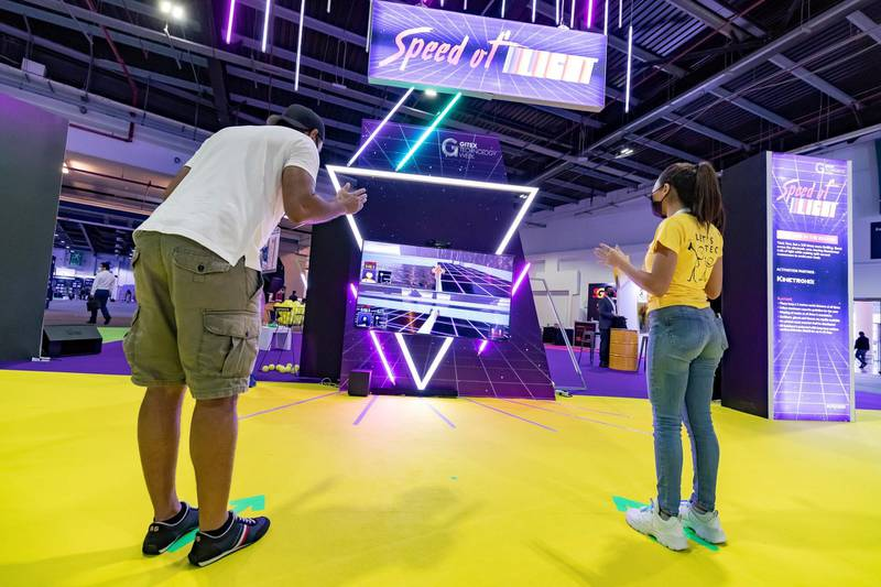 Dubai, United Arab Emirates - December 06, 2020:People play Speed of Light a Tron like game where people use their bodies as controllers during GITEX 2020 at the World Trade Centre. December 6th, 2020 in Dubai. Chris Whiteoak / The National
