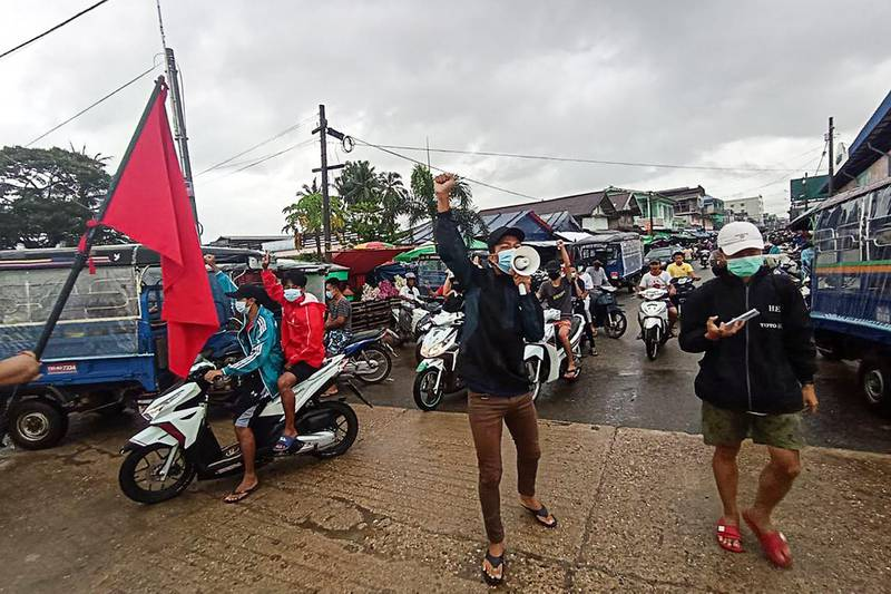 """This handout photo taken and released by Dawei Watch on June 14, 2021 shows protesters taking part in a demonstration against the military coup in Dawei. -----EDITORS NOTE --- RESTRICTED TO EDITORIAL USE - MANDATORY CREDIT """"AFP PHOTO / DAWEI WATCH """" - NO MARKETING - NO ADVERTISING CAMPAIGNS - DISTRIBUTED AS A SERVICE TO CLIENTS  / AFP / DAWEI WATCH / Handout / -----EDITORS NOTE --- RESTRICTED TO EDITORIAL USE - MANDATORY CREDIT """"AFP PHOTO / DAWEI WATCH """" - NO MARKETING - NO ADVERTISING CAMPAIGNS - DISTRIBUTED AS A SERVICE TO CLIENTS"""