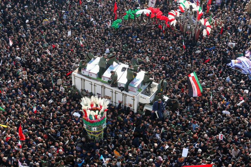 """Iranian people attend a funeral procession for Iranian Major-General Qassem Soleimani, head of the elite Quds Force, and Iraqi militia commander Abu Mahdi al-Muhandis, who were killed in an air strike at Baghdad airport, in Tehran, Iran January 6, 2020. Nazanin Tabatabaee/WANA (West Asia News Agency) via REUTERS/File photo      ATTENTION EDITORS - THIS IMAGE HAS BEEN SUPPLIED BY A THIRD PARTY     TPX IMAGES OF THE DAY      SEARCH """"GLOBAL POY"""" FOR THIS STORY. SEARCH """"REUTERS POY"""" FOR ALL BEST OF 2020 PACKAGES."""