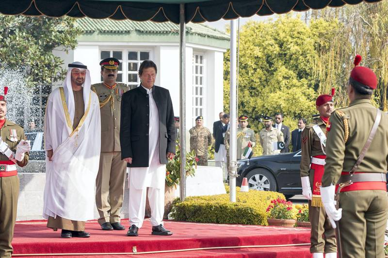 ISLAMABAD, PAKISTAN - January 06, 2019: HH Sheikh Mohamed bin Zayed Al Nahyan, Crown Prince of Abu Dhabi and Deputy Supreme Commander of the UAE Armed Forces (centre L) and HE Imran Khan, Prime Minister of Pakistan (centre R), stand for a national anthem, during a reception held at the Prime Minister's residence. ( Rashed Al Mansoori / Ministry of Presidential Affairs ) ---