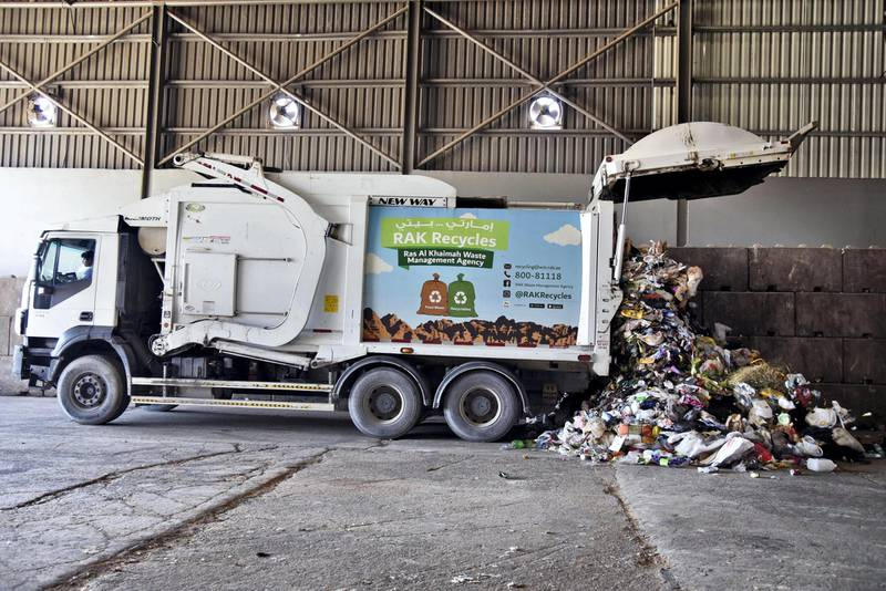 A truck dumps waste at the Material Recovery Facility during its opening ceremony in Ras Al Khaimah, UAE, Wednesday, Nov. 27, 2019. Shruti Jain The National