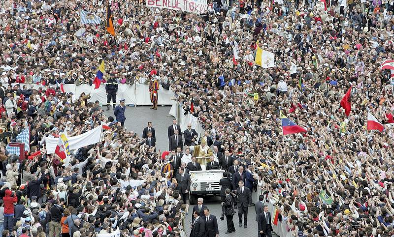 VATICAN CITY, VATICAN - APRIL 24:  Pope Benedict XVI waves to the masses from the Popemobile after leading his inaugural mass in Saint Peter's Square April 24, 2005 in Vatican City. Hundreds of thousands of pilgrims attended the mass led by the 265th Pope of the Roman Catholic Church.  (Photo by Mario Tama/Getty Images)