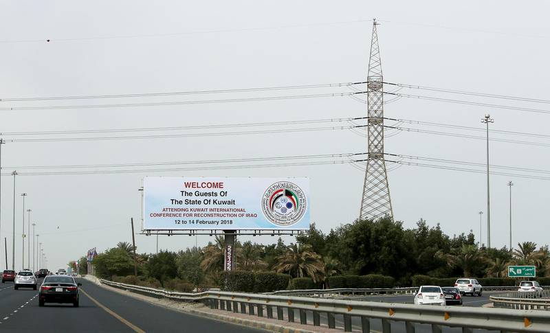 A picture taken on February 9, 2018 shows a billboard welcoming guests participating in the Kuwait International Conference for Reconstruction of Iraq, along a highway in the capital Kuwait City. / AFP PHOTO / YASSER AL-ZAYYAT