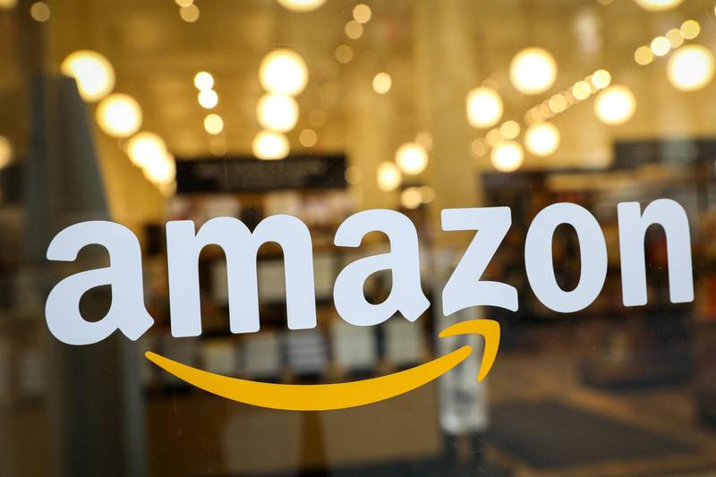 FILE PHOTO: The logo of Amazon is seen on the door of an Amazon Books retail store in New York City, U.S., February 14, 2019. REUTERS/Brendan McDermid/File Photo    To match Special Report AMAZON-INDIA/OPERATION