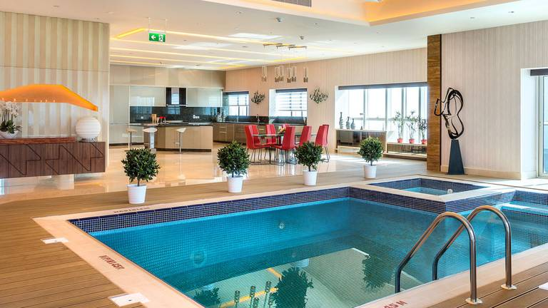 An image that illustrates this article See inside the Dubai Marina penthouse with a pool in the living room