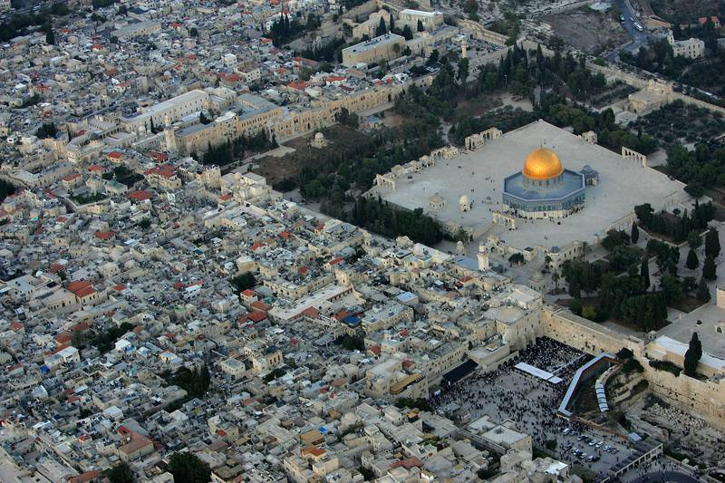 JERUSALEM, ISRAEL - OCTOBER 20: The golden Dome of the Rock Islamic shrine dominates the Temple Mount on which it stands, and below it the Western Wall, Judaism's holiest shrine October 20, 2005 in this aerial view of Jerusalem's Old City. The picture, taken facing north-east, also shows the Muslim Quarter of the Old City, at left. (Photo by David Silverman/Getty Images)