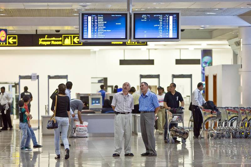 United Arab Emirates - Dubai - August 2, 2010.  BUSINESS: Passengers check their flight schedules at Dubai International Airport Terminal 2 in Dubai on Monday, August 2, 2010. Amy Leang/The National