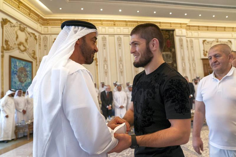 ABU DHABI, UNITED ARAB EMIRATES - September 09, 2019: HH Sheikh Mohamed bin Zayed Al Nahyan, Crown Prince of Abu Dhabi and Deputy Supreme Commander of the UAE Armed Forces (L), receives Khabib Nurmagomedov, UFC Lightweight Champion and winner of UFC 242 Abu Dhabi (2nd L), during a Sea Palace barza.  ( Mohamed Al Hammadi / Ministry of Presidential Affairs ) ---