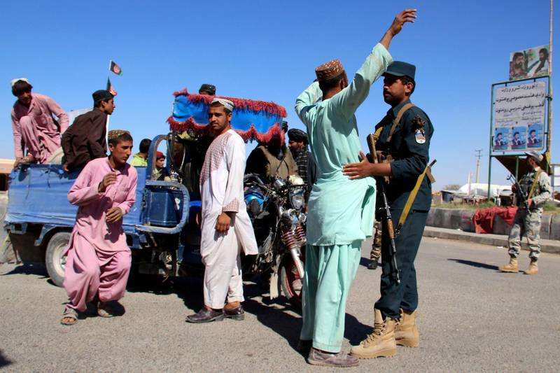 epa07104745 Afghan security officials check people and vehicles on a road side as security has been intensified ahead of parliamentary elections in Helmand, Afghanistan, 19 October 2018. More than 2,500 candidates are running for the 249 seats in the Afghan Parliament, with the Oct. 20 elections denounced by insurgents as a flawed process aimed at legitimizing the presence of foreign troops in Afghanistan. The Afghan government has deployed 54,000 soldiers to secure the peace during the polls, but 2,384 of the 7,384 polling stations are in areas under Taliban control and will remain closed on election day, according to the country's Independent Election Commission.  EPA/WATAN YAR