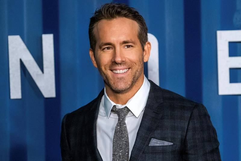 """FILE - In this Tuesday, Dec. 10, 2019 file photo, Ryan Reynolds attends the premiere of Netflix's """"6 Underground"""" at The Shed at Hudson Yards on in New York. Hollywood stars Ryan Reynolds and Rob McElhenney could be getting into the soccer business. Wrexham is a Welsh team which plays in the fifth tier of English soccer. It has revealed on Wednesday, Sept. 23, 2020 that Reynolds and McElhenney are the """"two extremely well-known individuals"""" the club has previously said are interested in investing 2 million pounds ($2.5 million). (Photo by Charles Sykes/Invision/AP, file)"""