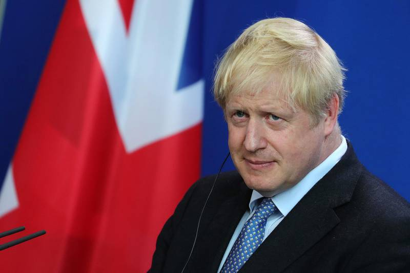 Boris Johnson, U.K. prime minister, listens beside Angela Merkel, Germany's chancellor, not pictured, during a news conference at the Chancellery in Berlin, Germany, on Wednesday, Aug. 21, 2019. At their first meeting since Johnson became British prime minister, both said they wanted to see the U.K. leave the European Union with a divorce agreement on Oct. 31. Photographer: Krisztian Bocsi/Bloomberg