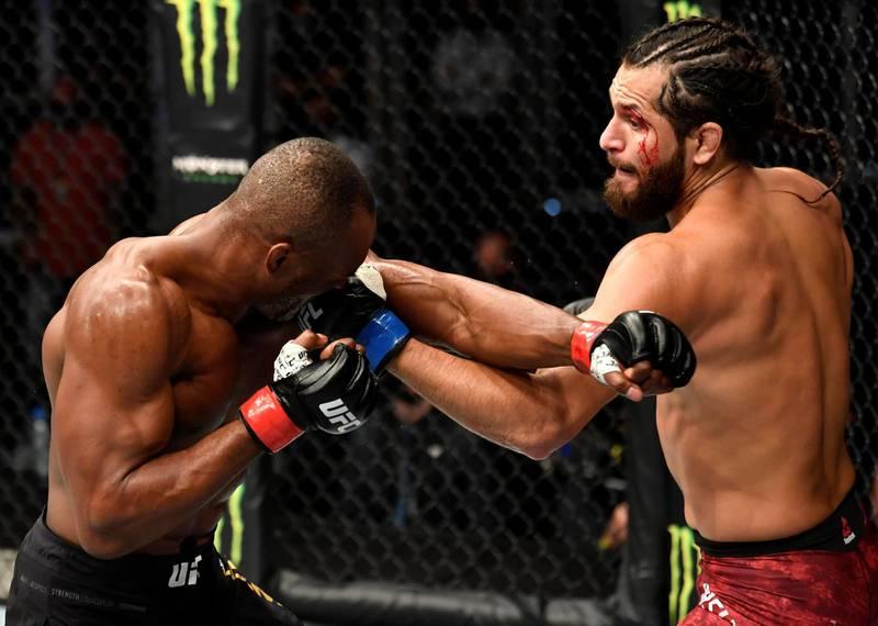 ABU DHABI, UNITED ARAB EMIRATES - JULY 12: (R-L) Jorge Masvidal punches Kamaru Usman of Nigeria in their UFC welterweight championship fight during the UFC 251 event at Flash Forum on UFC Fight Island on July 12, 2020 on Yas Island, Abu Dhabi, United Arab Emirates. (Photo by Jeff Bottari/Zuffa LLC) *** Local Caption *** ABU DHABI, UNITED ARAB EMIRATES - JULY 12: (R-L) Jorge Masvidal punches Kamaru Usman of Nigeria in their UFC welterweight championship fight during the UFC 251 event at Flash Forum on UFC Fight Island on July 12, 2020 on Yas Island, Abu Dhabi, United Arab Emirates. (Photo by Jeff Bottari/Zuffa LLC)