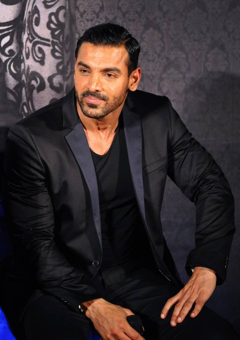 Indian Bollywood actor John Abraham attends the trailer launch of upcoming Hindi film 'Welcome Back' in Mumbai late on July 6, 2015.   AFP PHOTO (Photo by STR / AFP)
