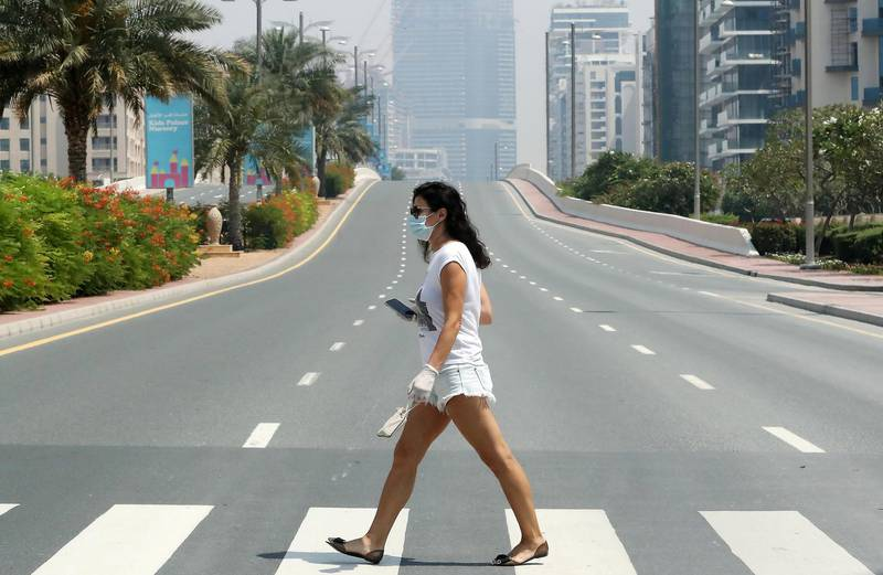 DUBAI, UNITED ARAB EMIRATES , April 17– 2020 :- One of the lady wearing  protective face mask on Palm Jumeirah in Dubai. Dubai is conducting 24 hours sterilisation programme across all areas and communities in the Emirate and told residents to stay at home. UAE government told residents to wear face mask and gloves all the times outside the home whether they are showing symptoms of Covid-19 or not.  (Pawan Singh / The National) For News/Online/Instagram