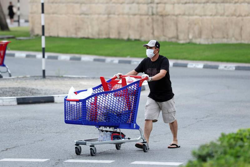 Dubai, United Arab Emirates - Reporter: N/A: People shop for their essential supplies at Carrefour, Ibn Battuta due to the corona outbreak. Sunday, April 12th, 2020. Dubai. Chris Whiteoak / The National