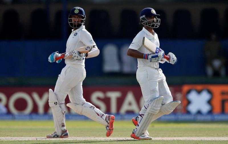 Cricket - Sri Lanka v India - Second Test Match - Colombo, Sri Lanka - August 3, 2017 - India's Cheteshwar Pujara and Ajinkya Rahane run between wickets. REUTERS/Dinuka Liyanawatte