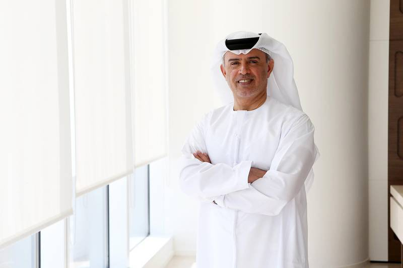 DUBAI , UNITED ARAB EMIRATES – Dec 15 , 2016 : Hussain Ali Lootah , author of ' Between two Wives'  at his office in Vision Tower 1 in Downtown Dubai in Dubai. ( Pawan Singh / The National ) For Review. Story by Rym Ghazal. ID No -  38741 *** Local Caption ***  PS1512- HUSSAIN ALI LOOTAH02.jpg