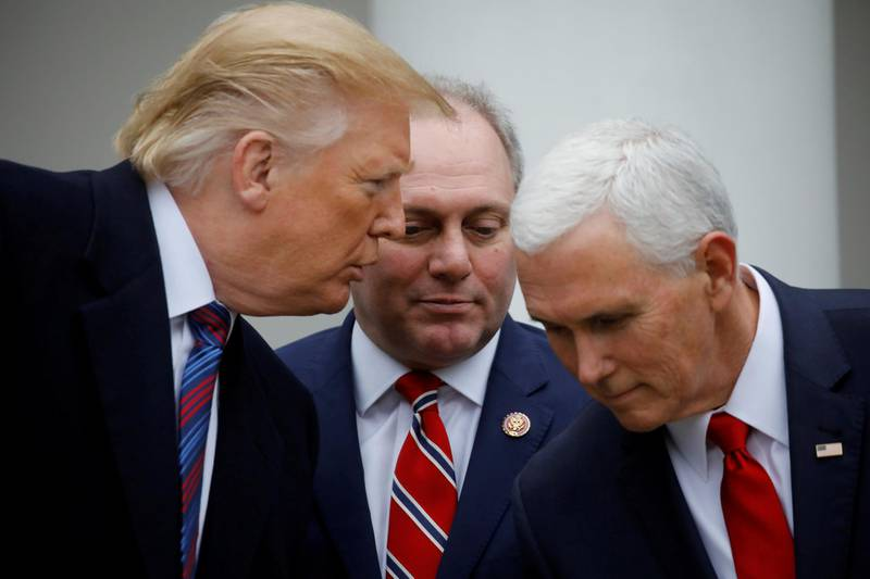 U.S. President Donald Trump confers with Vice President Mike Pence and House Minority Whip Steve Scalise (R-LA) as they faced to reporters in the Rose Garden after the president met with U.S. Congressional leaders about the government shutdown and border security at the White House in Washington, U.S., January 4, 2019. REUTERS/Carlos Barria     TPX IMAGES OF THE DAY