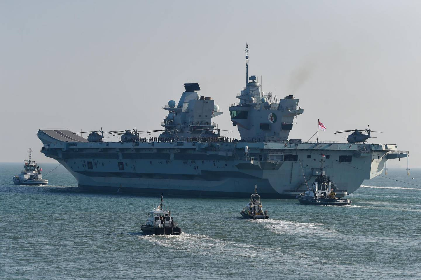 PORTSMOUTH, ENGLAND - SEPTEMBER 21: HMS Queen Elizabeth departs from the Naval base on September 21, 2020 in Portsmouth, England. The £3 billion aircraft carrier was due to sail last week but was delayed due to high easterly winds. The 65,000-tonne aircraft carrier's entire crew has been retested for Covid-19 with approximately 100 sailors having to self-isolate after 'fewer than 10' tested positive. (Photo by Finnbarr Webster/Getty Images)