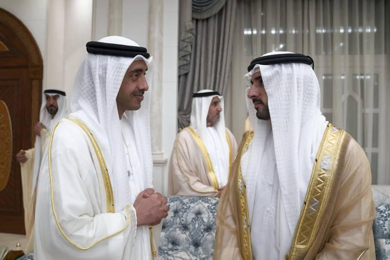 ABU DHABI, UNITED ARAB EMIRATES - August 21, 2018: HH Sheikh Abdullah bin Zayed Al Nahyan, UAE Minister of Foreign Affairs and International Cooperation (L) and HH Sheikh Hamdan bin Mohamed Al Maktoum, Crown Prince of Dubai (R) attend an Eid Al Adha reception at Mushrif Palace.  ( Mohamed Al Hammadi / Crown Prince Court - Abu Dhabi ) ---