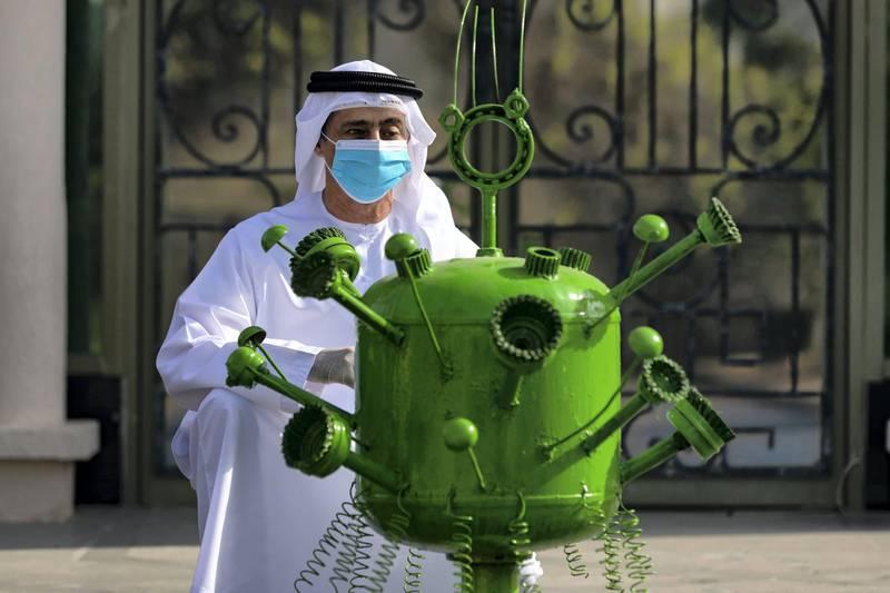 Ras Al Khaimah, United Arab Emirates - Reporter: N/A: Artist Tariq Al Salmon with his Covid-19 sculpture in Ras Al Khaimah. Tuesday, May 19th, 2020. Ras Al Khaimah. Chris Whiteoak / The National