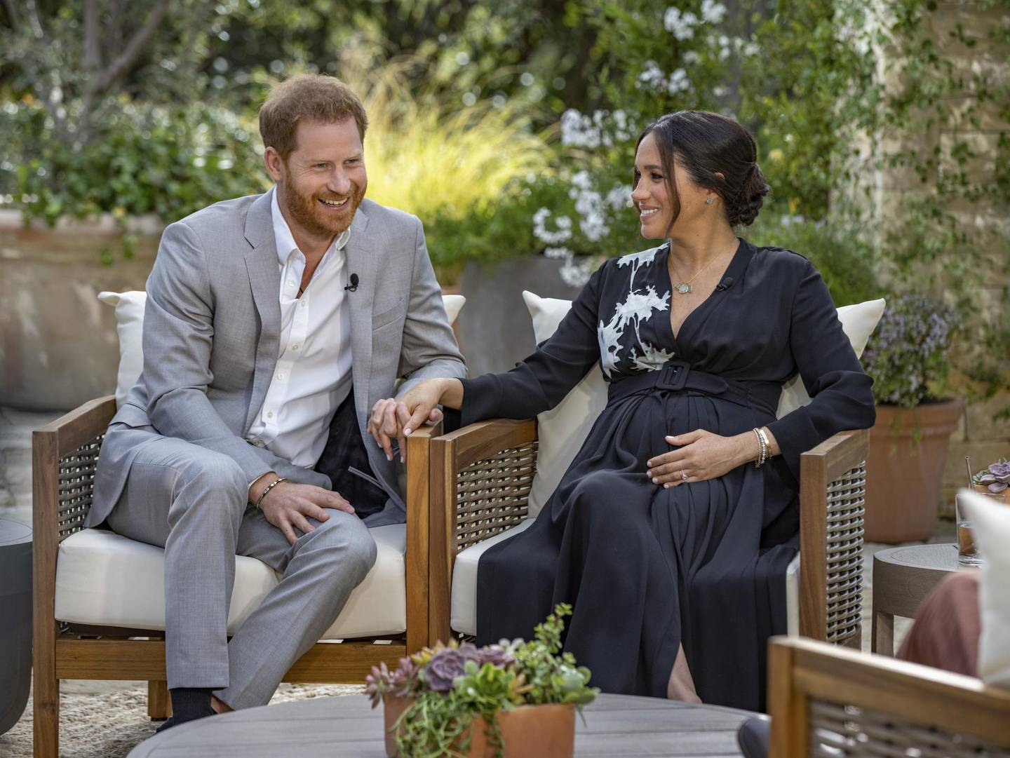 """This image provided by Harpo Productions shows Prince Harry, left, and Meghan, Duchess of Sussex, speaking about expecting their second child during an interview with Oprah Winfrey. """"Oprah with Meghan and Harry: A CBS Primetime Special"""" airs March 7 as a two-hour exclusive primetime special on the CBS Television Network. (Joe Pugliese/Harpo Productions via AP)"""