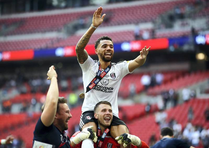 LONDON, ENGLAND - MAY 26:  Ryan Fredericks of Fulham celebrates with Marcus Bettinelli of Fulham following their sides victory in the Sky Bet Championship Play Off Final between Aston Villa and  Fulham at Wembley Stadium on May 26, 2018 in London, England.  (Photo by Clive Mason/Getty Images)