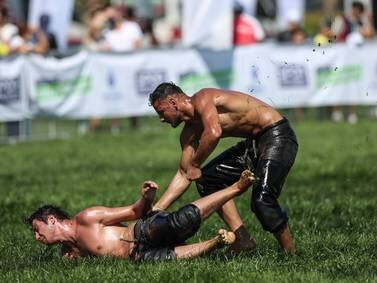 Turkish men slip and slide at the Ulugazi Oil Wrestling Festival in Istanbul - in pictures