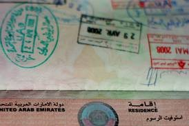 'Can a company stop me from accepting a new job if I am working on a visit visa?'