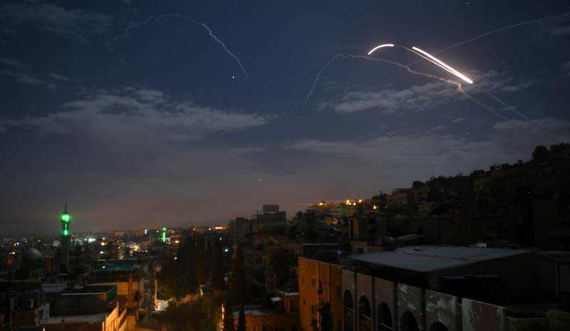 TOPSHOT - A picture taken early on January 21, 2019 shows Syrian air defence batteries responding to what the Syrian state media said were Israeli missiles targeting Damascus. Israel struck what it said were Iranian targets in Syria today in response to rocket fire it blamed on Iran, sparking concerns of an escalation after a monitor reported 11 fighters killed. Israel openly claimed responsibility for the strikes against facilities it said belonged to the Iranian Revolutionary Guards' Quds Force, continuing its recent practice of speaking more openly about such raids.  / AFP / STR