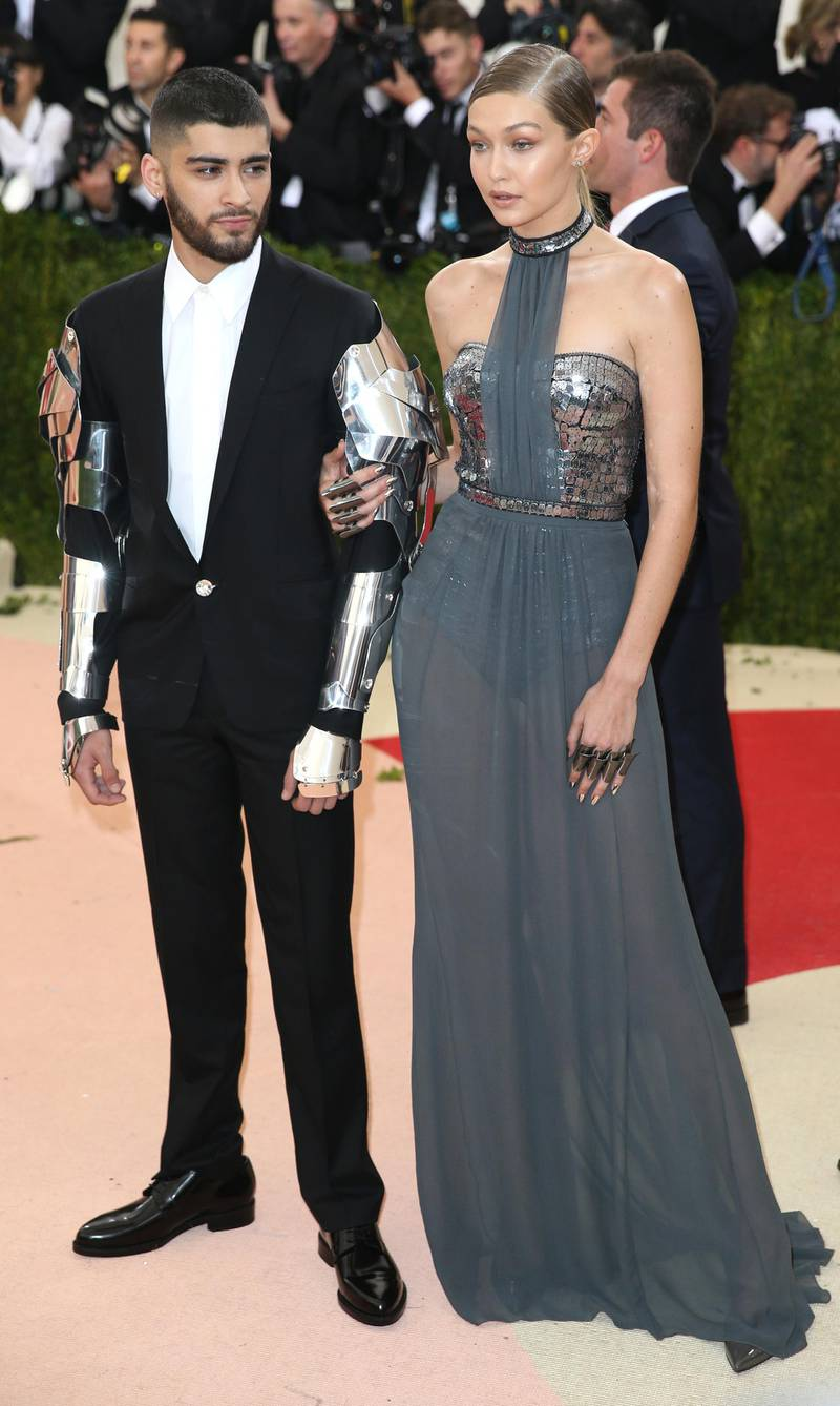 epa06601698 (FILE) - Zayn Malik (L) and Gigi Hadid arrive on the red carpet for the 2016 Costume Institute Benefit at The Metropolitan Museum of Art celebrating the opening of the exhibit 'Manus x Machina: Fashion in an Age of Technology' in New York, New York, USA, 02 May 2016. According to media reports citing the social media accounts of Hadid and Malik on 13 March 2018, the couple broke up after a two year relationship.  EPA-EFE/JUSTIN LANE
