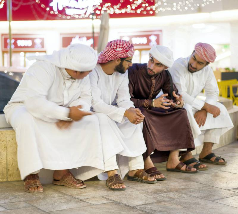 Group of Middle Eastern young men talking