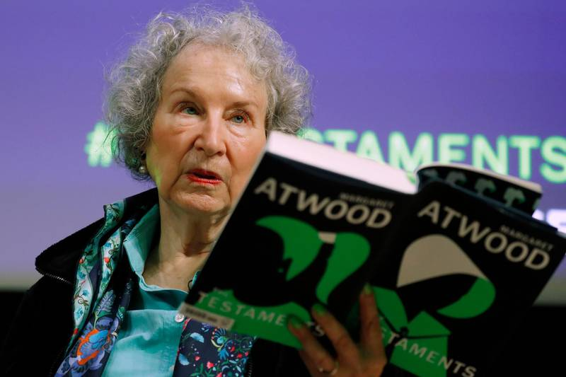 """FILE - In this Sept. 10, 2019, file photo, Canadian author Margaret Atwood holds a copy of her book """"The Testaments,"""" during a news conference in London. Atwood, whose sweeping body of work includes """"The Handmaid's Tale,"""" depicting a nightmarish future for the United States, is this year's winner of a lifetime achievement award celebrating literature's power to foster peace, social justice and global understanding, officials of the Dayton Literary Peace Prize officials announced Monday, Sept. 14, 2020. (AP Photo/Alastair Grant, File)"""