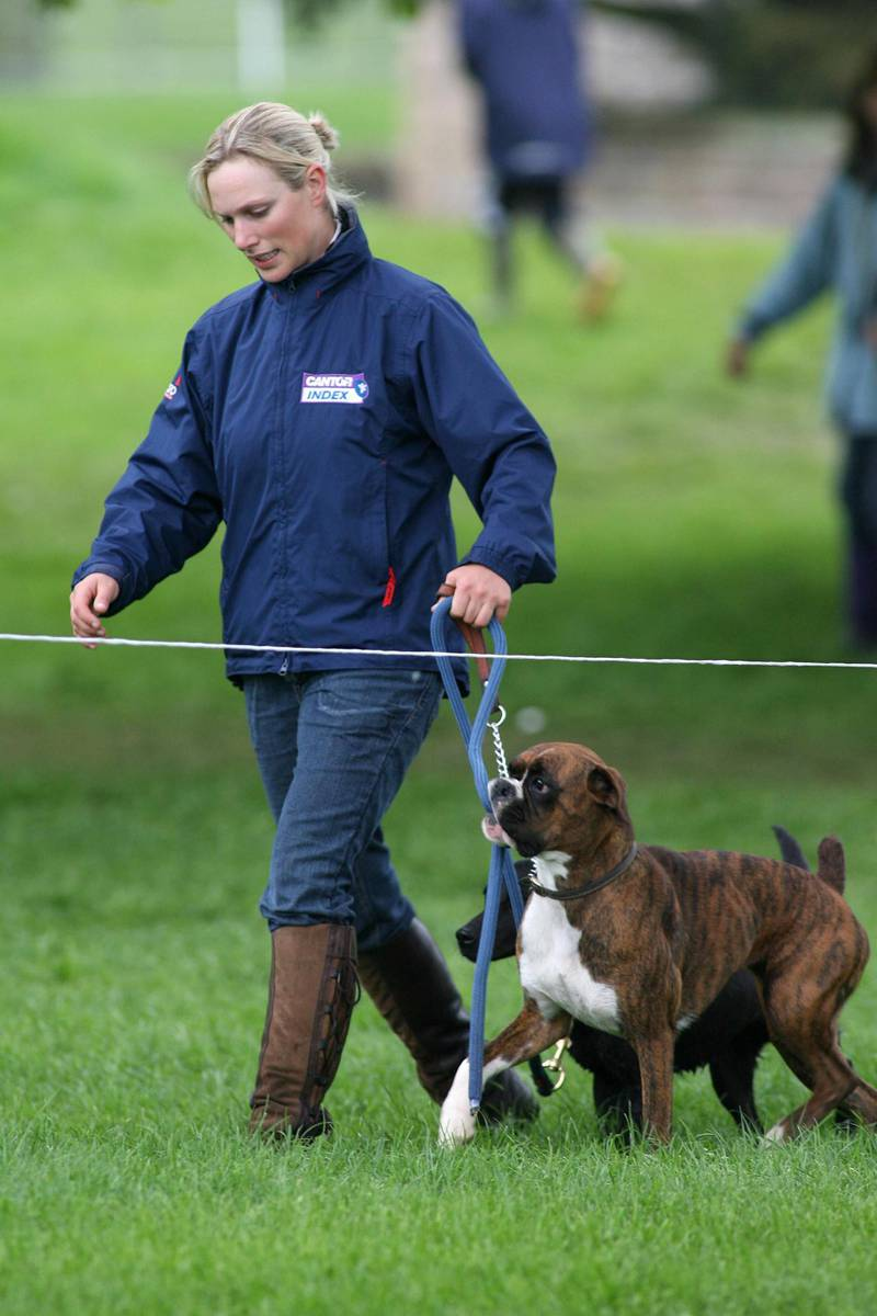 CHATSWORTH, ENGLAND - MAY 14:  Zara Phillips walks the cross country course with her two dogs on the second day of the Chatsworth SsangYong Horse Trials May 14, 2006 in Chatsworth, England.  (Photo by Ben Stansall/Getty Images)