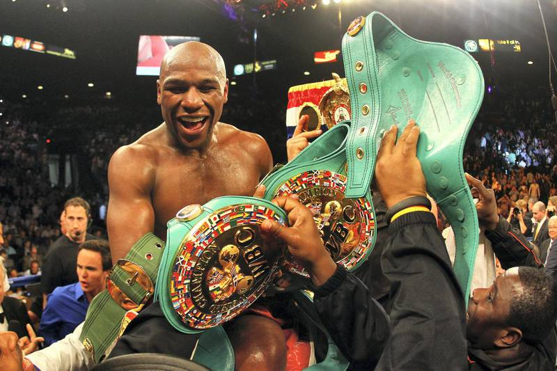 LAS VEGAS, NV - MAY 05:  Floyd Mayweather Jr. celebrates after defeating Miguel Cotto by unanimous decision during their WBA super welterweight title fight at the MGM Grand Garden Arena on May 5, 2012 in Las Vegas, Nevada.  (Photo by Al Bello/Getty Images)