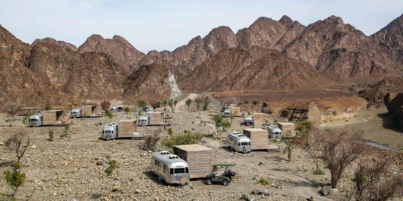 """This picture taken on February 15, 2019 shows a view of a tourist caravan camped at a mountain campsite in the Dubai emirate's exclave of Hatta, near the Omani border. Some 100 kilometres from Dubai's skyscrapers, """"glamping"""" in luxurious trailer-style set-ups and mountainside lodgings is the next big thing in the desert country. Betting on tourism at a time of low oil prices, Dubai has pushed a blend of camping and luxury hotels -- """"glamping"""", short for """"glamourous camping"""". The city welcomed a record 15.92 million visitors in 2018, many of whom were drawn to its mega malls, luxurious hotels and pristine beaches. / AFP / KARIM SAHIB"""