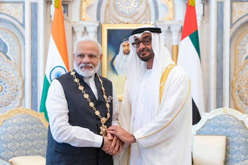 ABU DHABI, UNITED ARAB EMIRATES - August 24, 2019: HH Sheikh Mohamed bin Zayed Al Nahyan, Crown Prince of Abu Dhabi and Deputy Supreme Commander of the UAE Armed Forces (R), presents a Zayed Medal to HE Narendra Modi, Prime Minister of India (L), during a reception at Qasr Al Watan.  ( Rashed Al Mansoori / Ministry of Presidential Affairs ) ---
