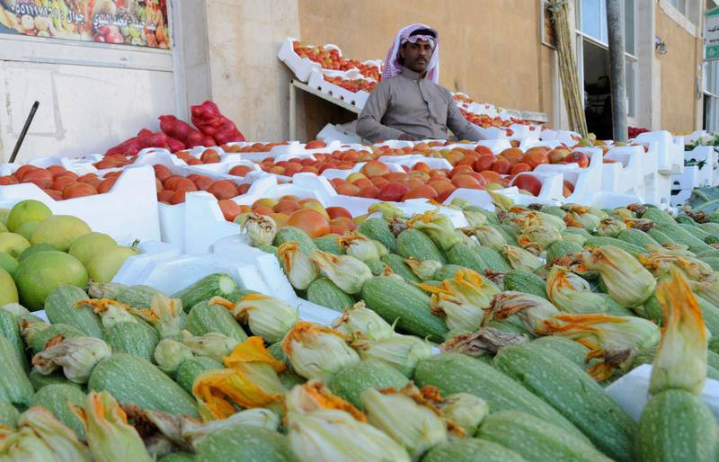 A Saudi vendor rests as he sells vegetables at a shop in Tabuk, 1500 km (932 miles) from Riyadh November 30, 2013. Saudi Arabia's crackdown on foreign workers has thrown millions of lives into turmoil and caused rioting in big cities, but the economy should benefit in the long run as Saudi nationals fill the gaps and cut their dependence on the state. REUTERS/Mohamed Alhwaity (SAUDI ARABIA - Tags: BUSINESS SOCIETY AGRICULTURE FOOD) - GM1E9C1084501