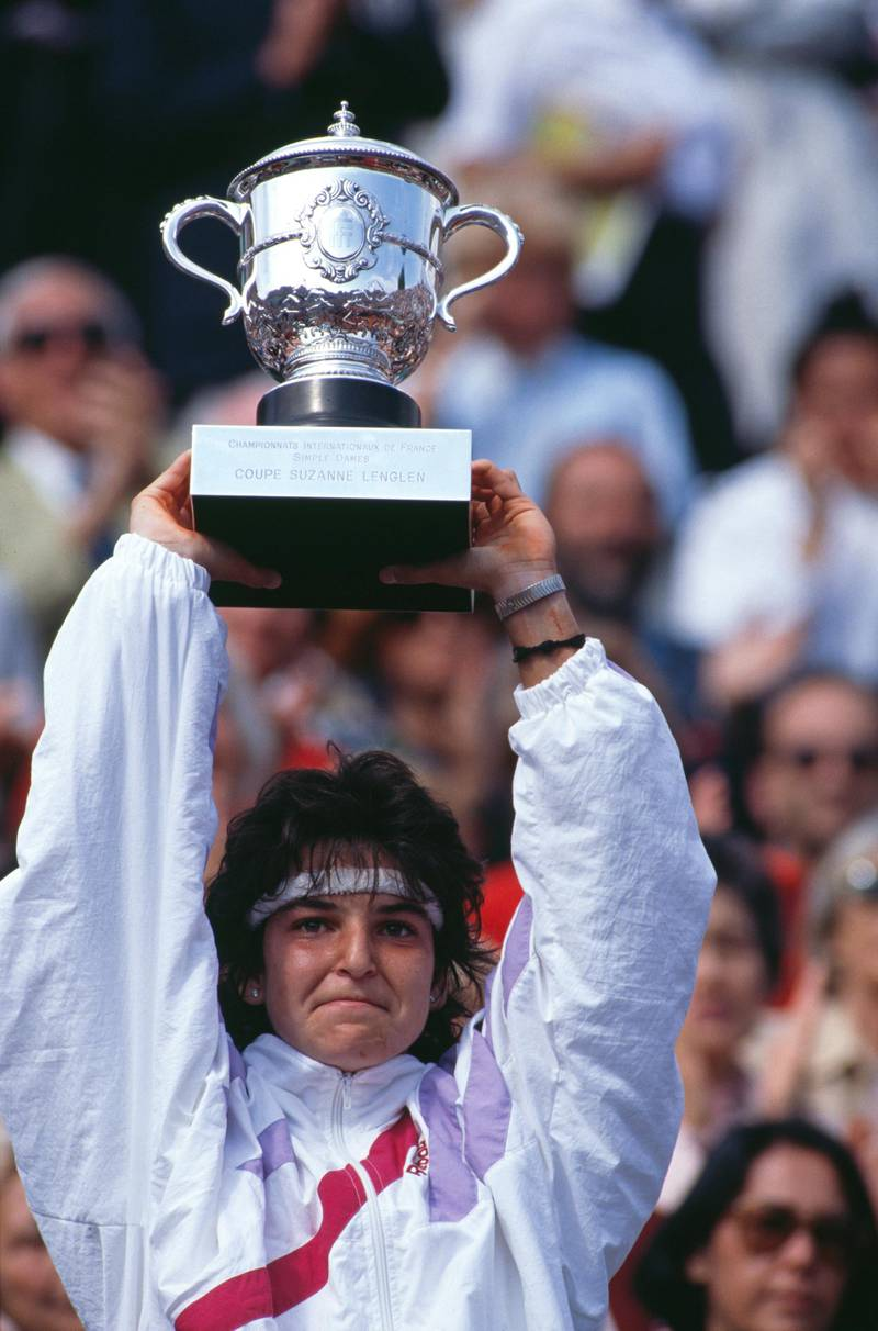 Arantxa Sanchez Vicario of Spain holds aloft the Suzanne Lenglen trophy after winning the Women's Singles Final match against Steffi Graf at the French Open Tennis Championship on 10 June 1989 at the Stade Roland Garros Stadium in Paris, France. (Photo by Simon Bruty/Getty Images)