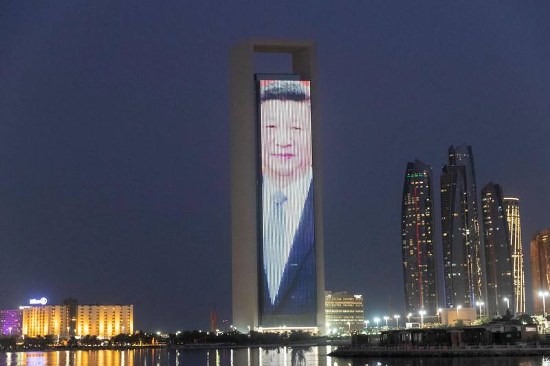 ABU DHABI, UNITED ARAB EMIRATES. 19 JULY 2018. A LED screen plays portraits of the UAE Leadership along with a message in Mandari honouring the Chinese Prime Ministers state visit to the UAE on the ADNOC HQ building on the Corniche. (Photo: Antonie Robertson/The National) Journalist: None. Section: National.