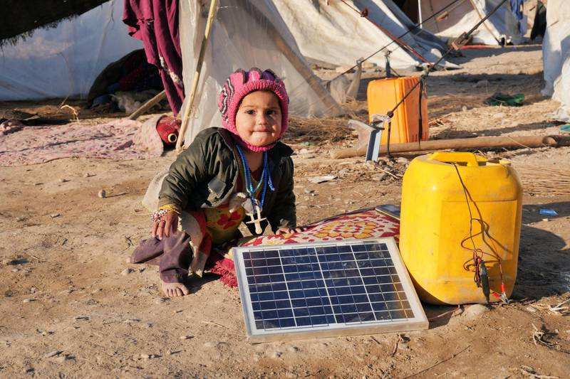 Pictured: A toddler plays in the first in an IDP camp located on the outskirts of Kandahar City. She lives among 250 families in a 4,000sqm space. All are lacking in warm clothes, bedding and food.  Photo by Charlie Faulkner January 2021